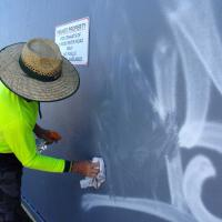 The city where I live will assist with graffiti removal on public property and businesses, but not on private property such as single-family detached homes. (This has to do with the large amount of graffiti within the city.) Does your city assist residents with graffiti removal, other than just giving advice?