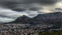 UFO-like lenticular clouds stunned residents when they formed over Cape Town, South Africa. Have you seen this image before reading this survey?