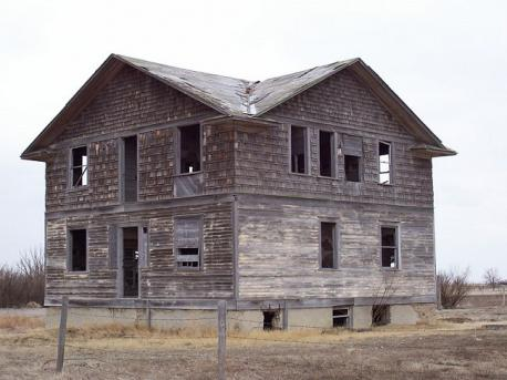 The definition of a ghost town varies between individuals, and between cultures (image: Robsart Hospital, one of many abandoned buildings in Robsart, Saskatchewan). Which statement do you agree with?