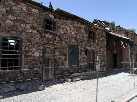 Ghost towns are common in mining or old mill town areas in the United States (image: 1881 Assay building in what was once Vulture City, a mining town in Wickenburg, Arizona, USA). Which States are you familiar with that have mining or old mill ghost towns?