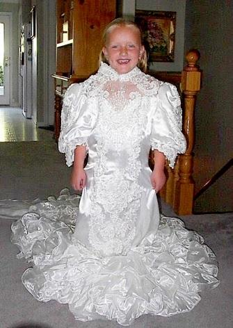 Pictured: (James in a wedding dress as a child).