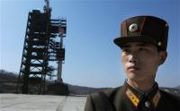 How should the U.S. respond if North Korea launches the Unha-3 rocket?