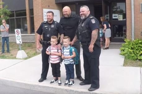 With the start of a new school year, a trio of Longueuil Quebec police officers fulfilled a promise they made four years ago. In 2014, Sergeant Detective Sébastien Glaude passed away after a battle with cancer. At the time his twin boys, William and Tristan were only about 1-year-old. Prior to his death, after receiving the bad news about his condition, Glaude shared a message with his fellow officers. All he asked them, explained Sergeant Dominic Ahier was