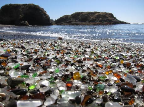 Unique Glass Beach in California near Fort Bragg in California formed after the trash dumped there for years by local residents was pounded into sand by the surf. The dumping was eventually prohibited, but the glass sand remains. Even though it has a dubious beginning, do you find this is an unusually beautiful beach?