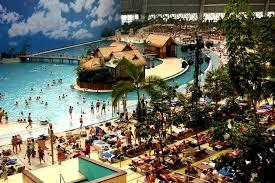 The Topical Island Resort, which holds the distinction of being the world's largest indoor waterpark, also features a tropical rain forest with over 50,000 plants, a 200 metre beach, and an outdoor area of over 35.000 square meters with two large pools, a sunbathing area, a beach volleyball and beach soccer field. And this little slice of paradise is located, oddly enough 50 kilometres from the southern boundary of Berlin, Germany. Even more strangely, it is housed in a former airship hangar (known as the Aerium), the biggest free-standing hall in the world. Have you ever heard of this or even been there?