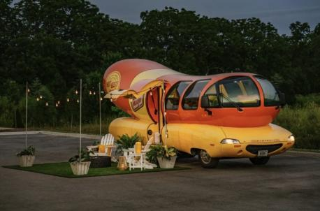 If you've ever dreamed of spending the night in a giant hot dog, it is now a possibility! The legendary Oscar Mayer Weinermobile is now available to rent on Airbnb. The hot-dog-on-wheels sleeps two and is available for $136 per night. The listing,