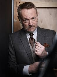 OK, make that two evil geniuses. Jared Harris usually plays eccentric weirdos, villains and people from another time. He is best known for playing Lane Pryce on Mad Men, Russel in Igby Goes Down and Mac McGrath in Mr. Deeds. His credits go far beyond these roles, as he has been on TV in The Other Boleyn Girl (2003), The Riches (2007), Fringe (2008), The Crown (2016), The Terror (2018) and Chernobyl (2019) and in movies, such as The Last of the Mohicans (1992), Natural Born Killers (1994), Smoke (1995), Happiness (1998), How to Kill Your Neighbor's Dog (2000), B. Monkey (1998), Shadow Magic (2000), Mr. Deeds (2002), Resident Evil: Apocalypse (2004) and The Curious Case of Benjamin Button (2008). Although British, one of his best talents is completely adopting a different accent and nailing it. Have you seen him in any of his onscreen roles?