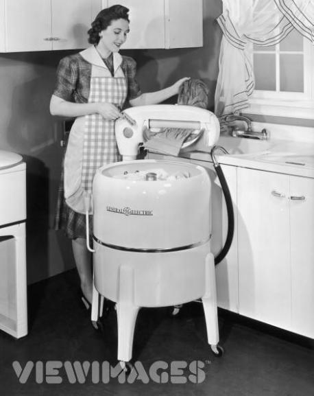 My grandmother had a washing machine like the one in the picture that hooked up to the sink in her laundry room. For years she refused to let us buy her new one because in her words