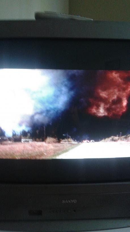 On the CTV Evening News, I was watching the fire burn. It was a very intense burning that possibly took shapes of evil entities. I took a couple of pictures with my cellphone. Take a look & let me know what you think...