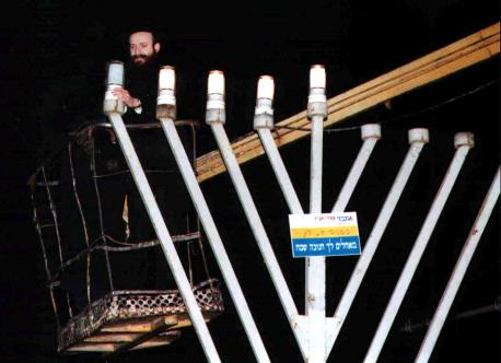 I found out this past week, a delightful surprise, that Chabad from my city will be lighting the Menorah in uptown Burbank. (Chabad, also known as Lubavitch, Habad and Chabad-Lubavitch) is an Orthodox Jewish, Hasidic movement. Chabad is today one of the world's best known Hasidic movements and is well known for its outreach. It is the largest Jewish religious organization in the world.) Of course, whenever there is a Jewish event law enforcement shows up to watch over the tribe. Is there ever law enforcement at any of your religious events?