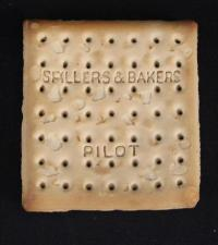 This biscuit, that looks more like a saltine cracker, survived the sinking of the Titanic in 1912. James and Mabel Fenwick were on the SS Carpathia for a three-month honeymoon to Europe when they picked up survivors from the Titanic. James took the Spillers & Bakers Pilot biscuit from the survival kit on one of the doomed ocean liner's lifeboats and kept it as a souvenir. James put it in a Kodak photographic envelope with notation of 'Pilot biscuit from Titanic lifeboat April 1912.' During such a tragic situation does it surprise you someone thought to take a souvenir?