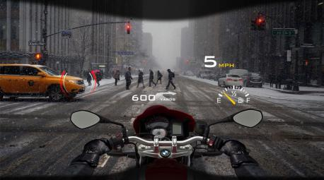 A company called DigiLens has just unveiled a kind of mobile AR tool that motorcyclists will soon be able to use to navigate the road. At first glance, the easiest way to describe the device is as