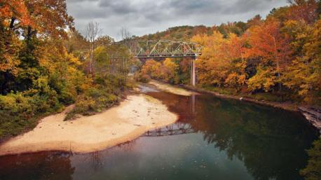 Arkansas: Buffalo National River - Spend a lazy autumn day floating down the beautiful Buffalo River, which in 1972, was declared the nation's first-ever national river, and you'll fall head over heels for fall in the Natural State. Along the way, you'll have plenty of chances to sunbathe on a sandbank under bluffs sporting a splash of color. Have you ever visited this destination?