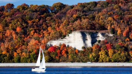 Illinois: Meeting of the Great Rivers Scenic Byway - This 30-mile stretch of road hugs the Mississippi River and connects small towns like Grafton—home to cute shops and a beloved waterfront bar—with historic, all-American Alton. Spend a couple of days in each place enjoying the autumn foliage and local apple orchards for a side of Illinois that is sure to be a pleasant surprise. Have you ever visited this destination?