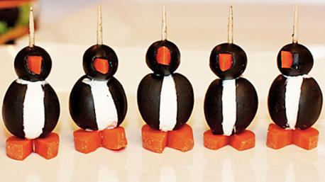 Last one for today! How about a Penguin canape made with a black olive, cream cheese, and carrot pieces?